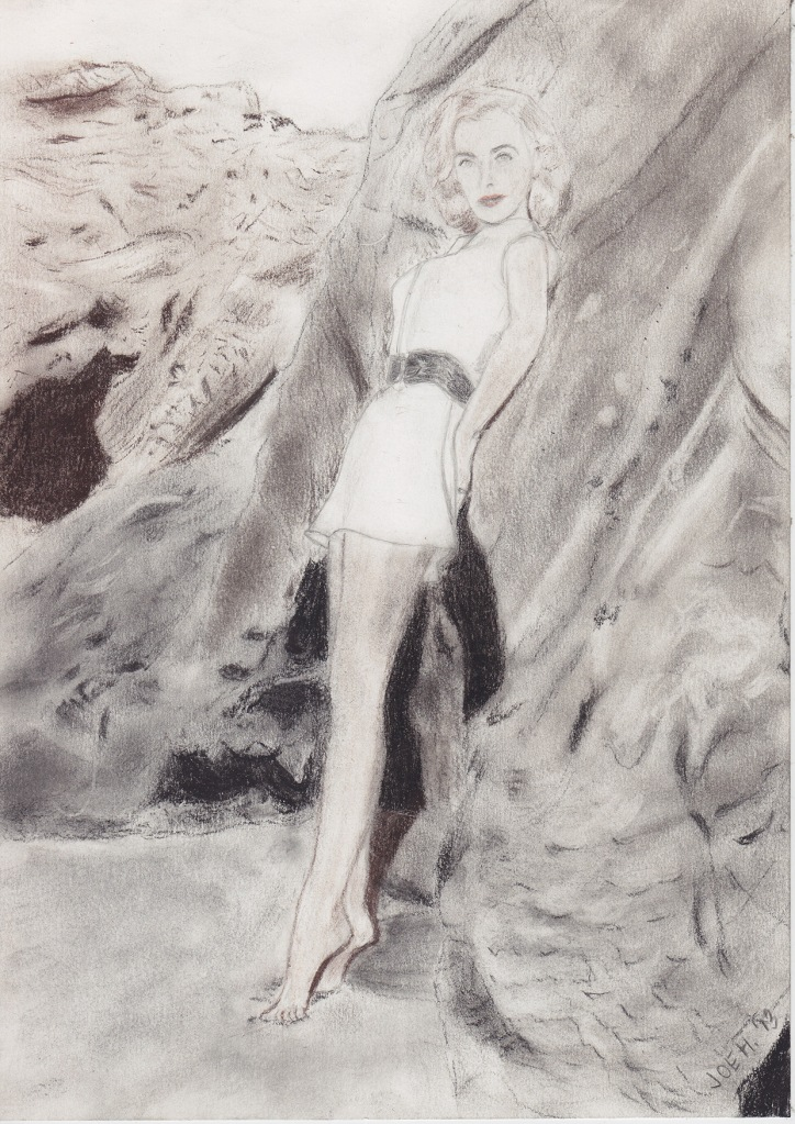 July 2013 - Experimenting with sepia - lovely Lizabeth Scott striking a classic pose by a rocky seaside.